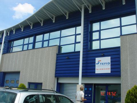 Vitres bureau fumées et teinte de protection solaire bâtiment à Salbris(41)